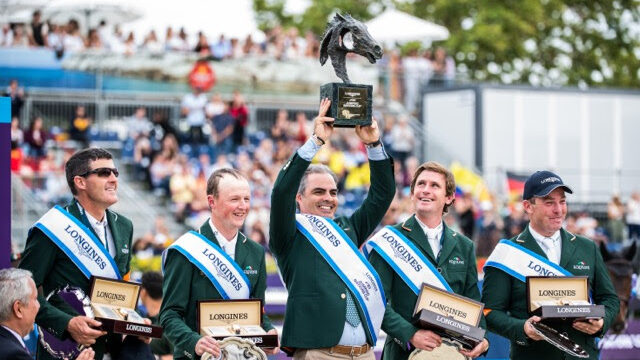 Chef d'Equipe Rodrigo Pessoa holds the trophy aloft as Team Ireland celebrate victory at the Longines FEI Jumping Nations Cup™ Final 2019 in Barcelona (ESP). (FEI/Lukasz Kowalski)